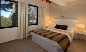 Una cama o camas en una habitación de Catalonia Sur Aparts-Spa