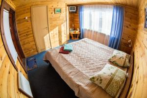 A bed or beds in a room at Hotel Dauria