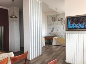 A television and/or entertainment center at Guci Hotel