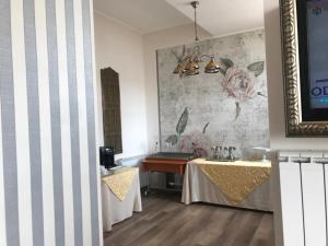 A kitchen or kitchenette at Guci Hotel