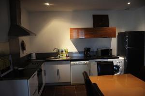 A kitchen or kitchenette at B&B Villa Chante Coucou