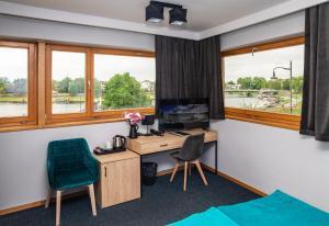 Televízia a/alebo spoločenská miestnosť v ubytovaní Hotel Pod Wawelem