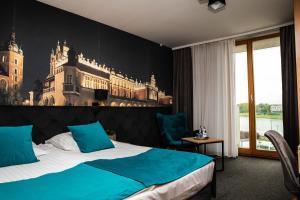 Posteľ alebo postele v izbe v ubytovaní Hotel Pod Wawelem