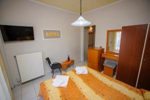 Ένα ή περισσότερα κρεβάτια σε δωμάτιο στο Hotel Europa