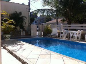 A piscina localizada em Pousada Rayer Land ou nos arredores