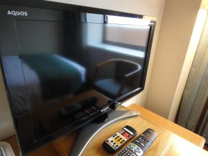 A television and/or entertainment center at Hotel New Otani Tottori