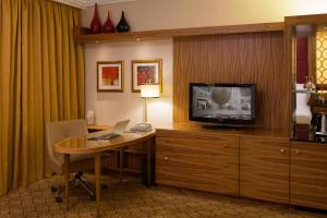 A television and/or entertainment center at Renaissance Moscow Monarch Centre Hotel by Marriott
