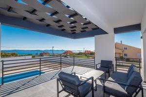 A balcony or terrace at Villa Barbara-holiday home with sea view