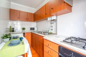 A kitchen or kitchenette at Casinhas Da Liberdade - Beach Apartments by Silver Prop