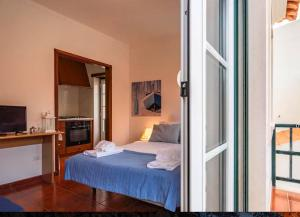 A bed or beds in a room at Casinhas Da Liberdade - Beach Apartments by Silver Prop