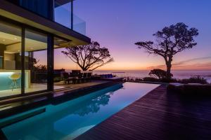 The swimming pool at or near Serenity Villa Camps Bay