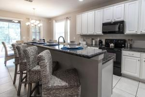 A kitchen or kitchenette at Golden Palms Resort 8 Bedroom Vacation Home with Pool 1721