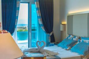 Postel nebo postele na pokoji v ubytování Hotel Panoramic