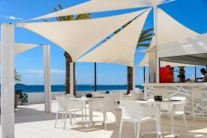 Een restaurant of ander eetgelegenheid bij Aparthotel Playasol Jabeque Soul