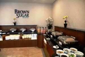 A kitchen or kitchenette at Hotel California Bandung