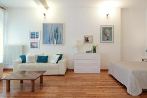 A seating area at PadovaResidence Apartments - Piazza delle Erbe