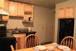 A kitchen or kitchenette at Waterton Lakes Lodge Resort