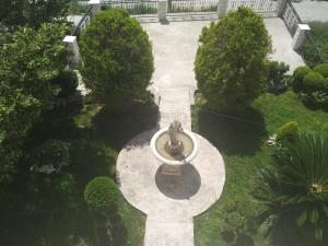 A garden outside Apartman Horizont