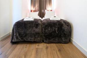 Een bed of bedden in een kamer bij Short Stay Group Harbour Apartments Amsterdam