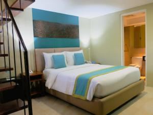 A bed or beds in a room at Boracay Haven Resort