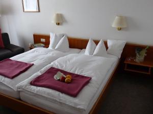 Ein Bett oder Betten in einem Zimmer der Unterkunft Landgasthaus Gieseke-Asshorn