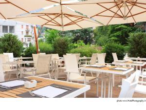Ein Restaurant oder anderes Speiselokal in der Unterkunft Grand Hotel Trento