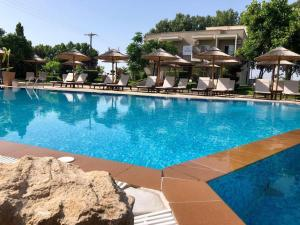 The swimming pool at or near Maison Hotel