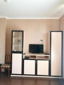 Телевизор и/или развлекательный центр в Hotel-Restaurant Atmosfera