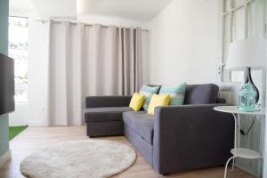 Zona de estar de Apartamento Aloe 2 dormitorios 4P piscina wifi by Lightbooking