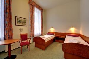 A bed or beds in a room at Complex Curie