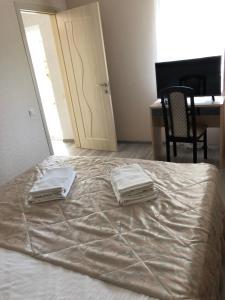 Кровать или кровати в номере Гостевой Дом Елена