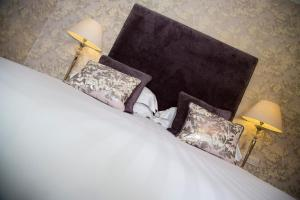 A bed or beds in a room at The Leathes Head Country House Hotel