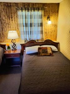 A bed or beds in a room at Falls Motel