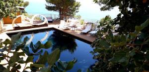 The swimming pool at or near Villa Sauci B&B