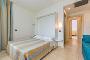 A bed or beds in a room at Almaluna Hotel & Resort