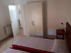 A bed or beds in a room at Borgo Antico Apartments