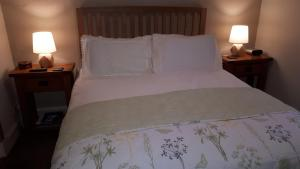 A bed or beds in a room at Achintee Farm Guest House