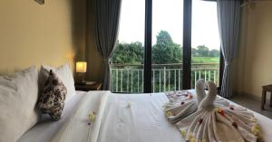 Oka's Guest Houseにあるベッド