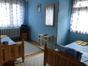 A bed or beds in a room at Mama Emiliya Guest House