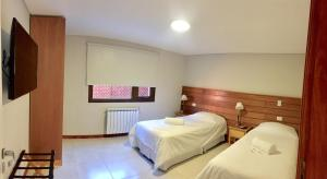 Una cama o camas en una habitación de Andino Aparts - El Chaltén