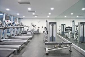 The fitness center and/or fitness facilities at Luxury City Apt with Pool, Gym, Spa, Netflix
