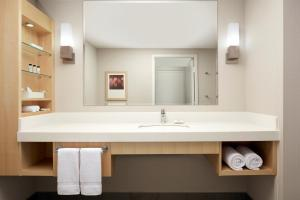 A bathroom at Delta Hotels by Marriott Montreal