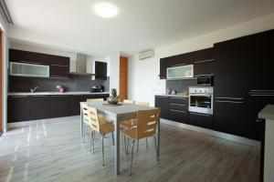 A kitchen or kitchenette at Residence Dolce Vita