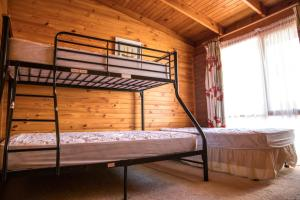 A bunk bed or bunk beds in a room at Water's Edge Bundalong