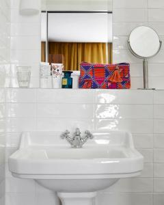 Um banheiro em Hotel Taylor