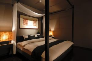 A bed or beds in a room at AROMA KURAVI (Adult Only)