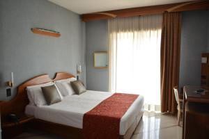 Letto o letti in una camera di Hotel Sunflower