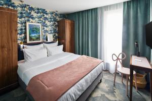 Cama ou camas em um quarto em Hotel Taylor