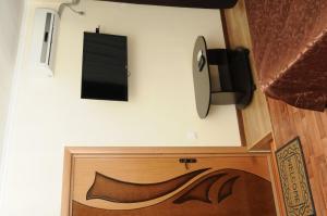 Телевизор и/или развлекательный центр в Гостевой Дом Александрия