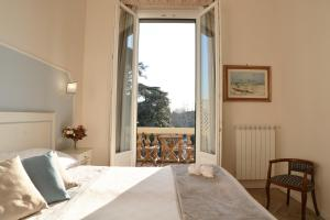 A bed or beds in a room at Dimora Salviati